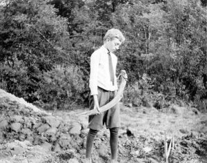 "Frederick B. Cook, the 12 year-old son of Hill-Stead farm manager, Allen B. Cook, holding a bone ""representing the first bone discovered"" when the mastodon remains were unearthed at Hill-Stead in August 1913."
