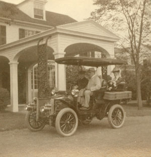Alfred & Ada Pope in their first automobile, a 1904 Model D White Steamer. Note the chauffeur and the right-hand drive, with the steering wheel on what is now the passenger side.